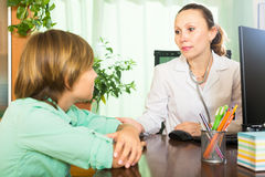 Female doctor and teenage Stock Photos