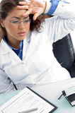 Female doctor in tension Stock Photo