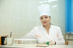 Female doctor with test tube Royalty Free Stock Photo