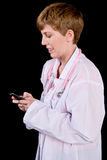 Female doctor texting on a cell phone Stock Photo