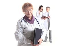 Female doctor therapist with laptop on blurred background of colleagues stock image