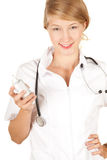 Female doctor with thermometer Royalty Free Stock Photos