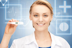 Female doctor with thermometer. Picture of attractive female doctor with thermometer Royalty Free Stock Photos