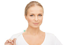 Female doctor with thermometer Royalty Free Stock Image