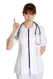 Female doctor threatens or pointing up Royalty Free Stock Photo