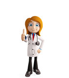 Female doctor with thumbs up pose Royalty Free Stock Image