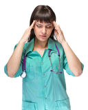 Female doctor tired with headache isolated on white Stock Photo