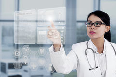 Female doctor touching medical interface. With modern technology stock images