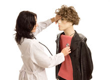 Female doctor treating a male mannequin Stock Photography