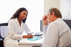 Female Doctor Treating Patient Suffering With Depression Royalty Free Stock Photography