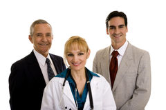 Female doctor with two businessmen Royalty Free Stock Photos