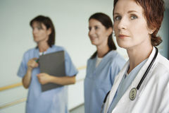 Female Doctor With Two Nurses Stock Images