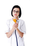 Female doctor in uniform holding pills royalty free stock photography