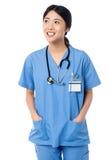 Female doctor in uniform looking away stock photos