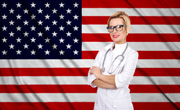 Female doctor and usa flag Stock Image