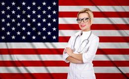 Female doctor and usa flag Stock Image