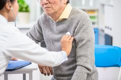 Female doctor do heartbeat check stock photo