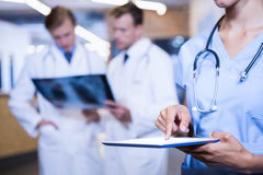 Female doctor using digital tablet Stock Photos