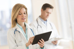Female Doctor Using Digital Tablet At Hospital Stock Photo