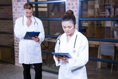 Female doctor using digital tablet near library Stock Photography