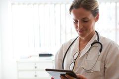 Female doctor using digital tablet in nursing home Stock Photos