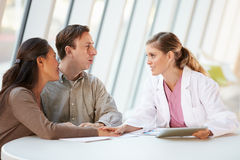 Female Doctor Using Digital Tablet Talking Royalty Free Stock Image