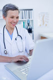 Female doctor using her laptop computer Royalty Free Stock Images