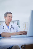 Female doctor using her laptop computer Stock Photos