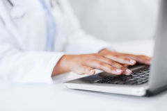 Female doctor using her laptop computer Royalty Free Stock Photography