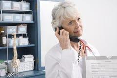 Female Doctor Using Landline Phone Stock Photos