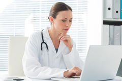 Female doctor using laptop Stock Images