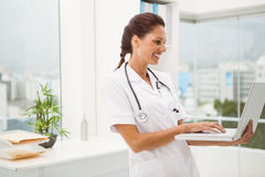 Female doctor using laptop in medical office Royalty Free Stock Photos