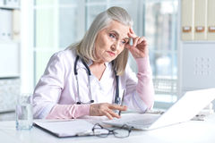 Female doctor using laptop Royalty Free Stock Photo