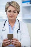 Female doctor using mobile phone Stock Photos