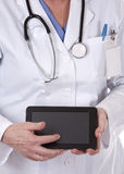 Female doctor using tablet Stock Photos