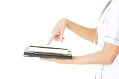 Female doctor using a tablet Royalty Free Stock Images