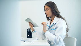 Female doctor using tablet computer in medical office.  stock video footage