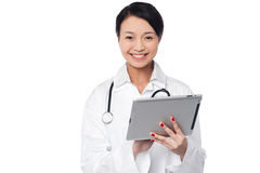 Female doctor using tablet pc Stock Photography