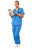 Female doctor using tablet pc Royalty Free Stock Photos