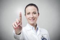 Female doctor using a touch screen interface Stock Image