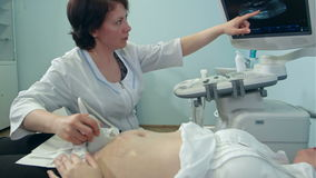 Female doctor using ultrasound and screening pregnant woman stock video