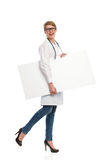 Female doctor walking with banner. Stock Image