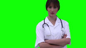 Female doctor walks in before crossing her arms Stock Images