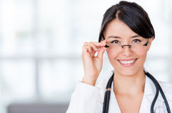 Female doctor wearing glasses Royalty Free Stock Images