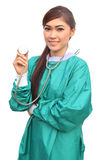 Female doctor wearing a green scrubs and stethoscope Royalty Free Stock Images