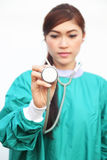 Female doctor wearing a green scrubs and stethoscope Royalty Free Stock Photo