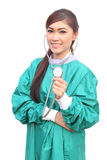 Female doctor wearing a green scrubs and stethoscope Stock Photography