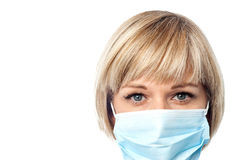 Female doctor wearing surgical mask Stock Photography