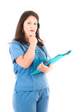 Female doctor on white carying patients history Royalty Free Stock Image