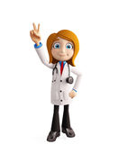 Female doctor with win sign Royalty Free Stock Photos